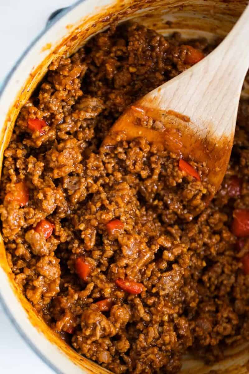 sloppy joe meat in pan with wooden spoon