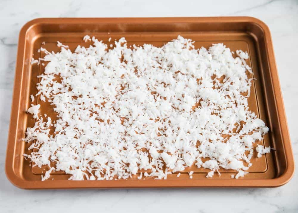 toasting coconut flakes on pan