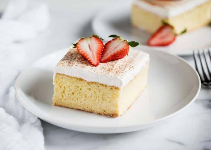 slice of tres leches cake on a white plate