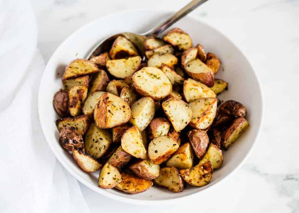 baked red potatoes in white bowl