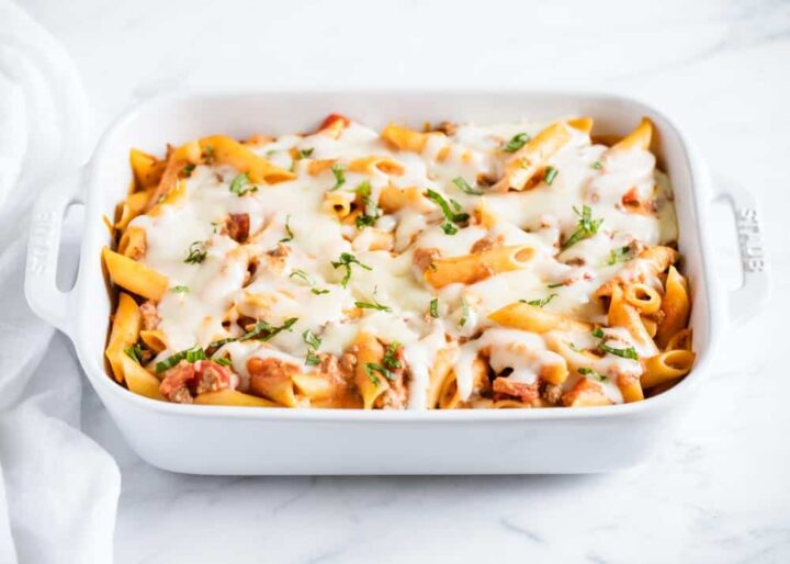baked ziti in a white casserole dish