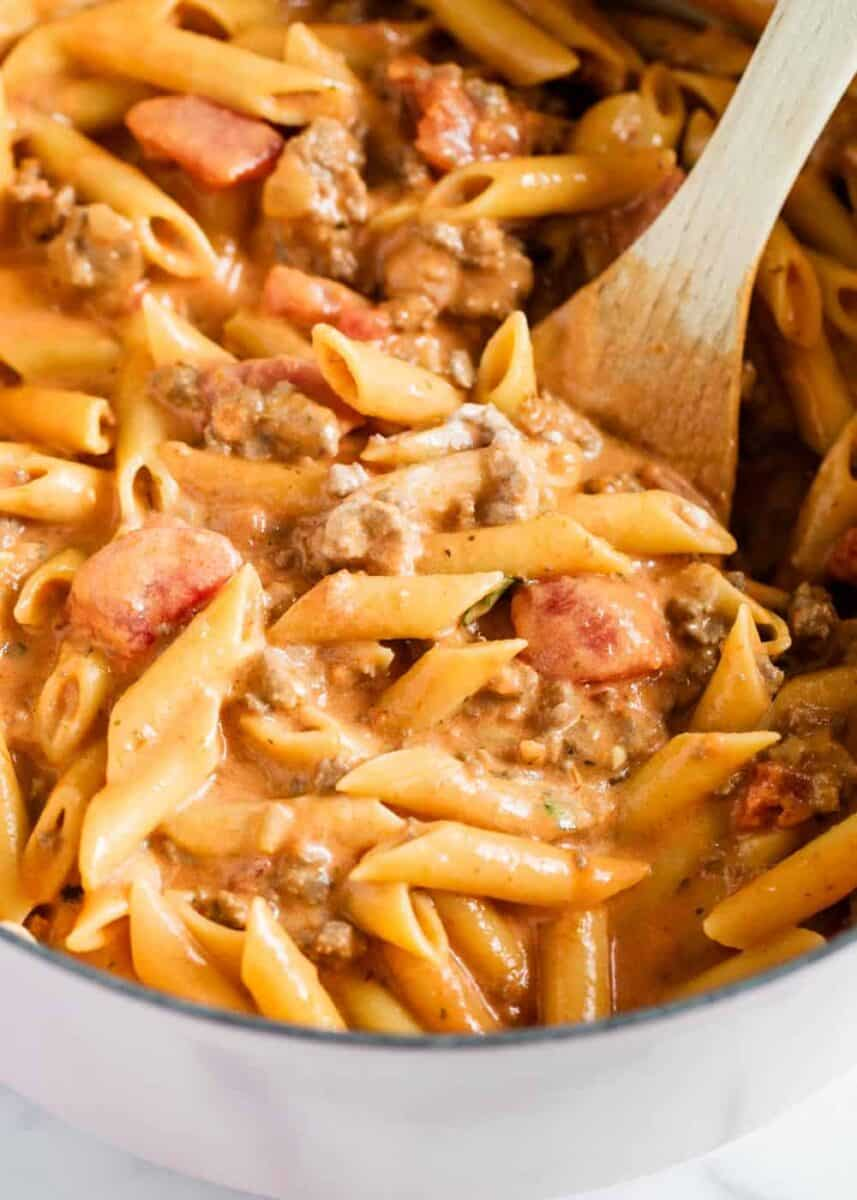 ziti pasta in pot with wooden spoon