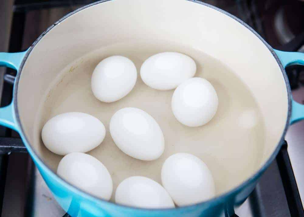 hard boiled eggs in water in dutch oven