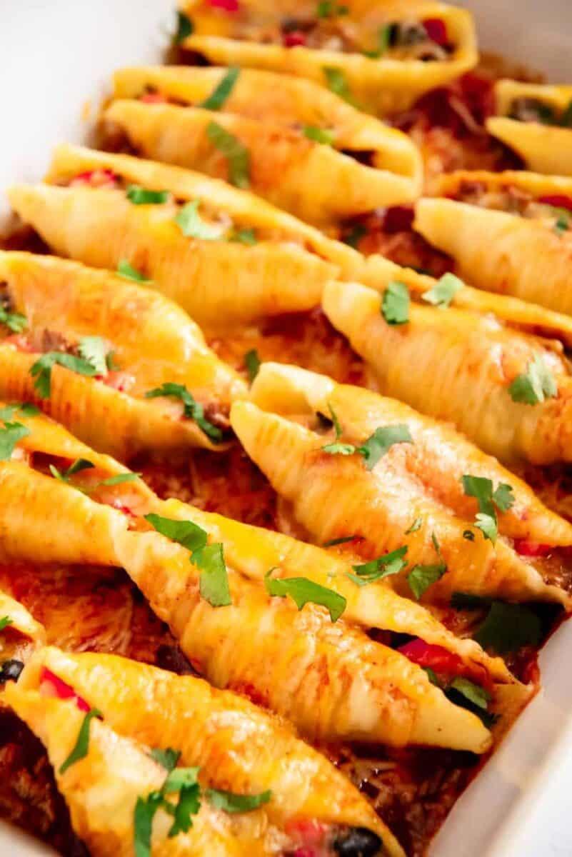 taco stuffed shells in baking dish