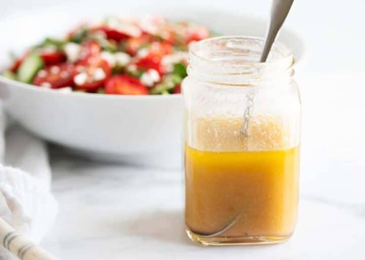 vinaigrette in jar with spoon