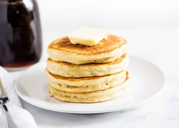 stack of buttermilk pancakes on a white plate