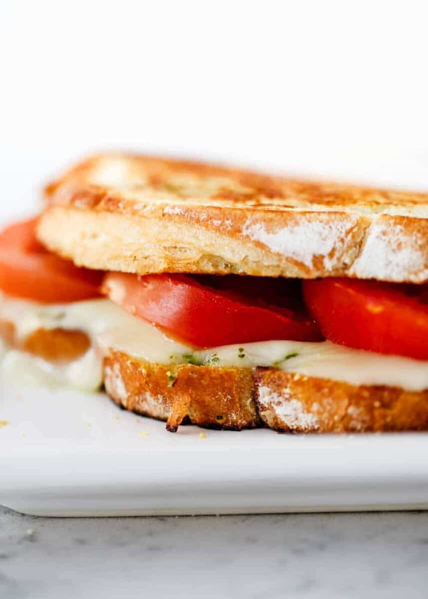 close up of caprese sandwich on plate
