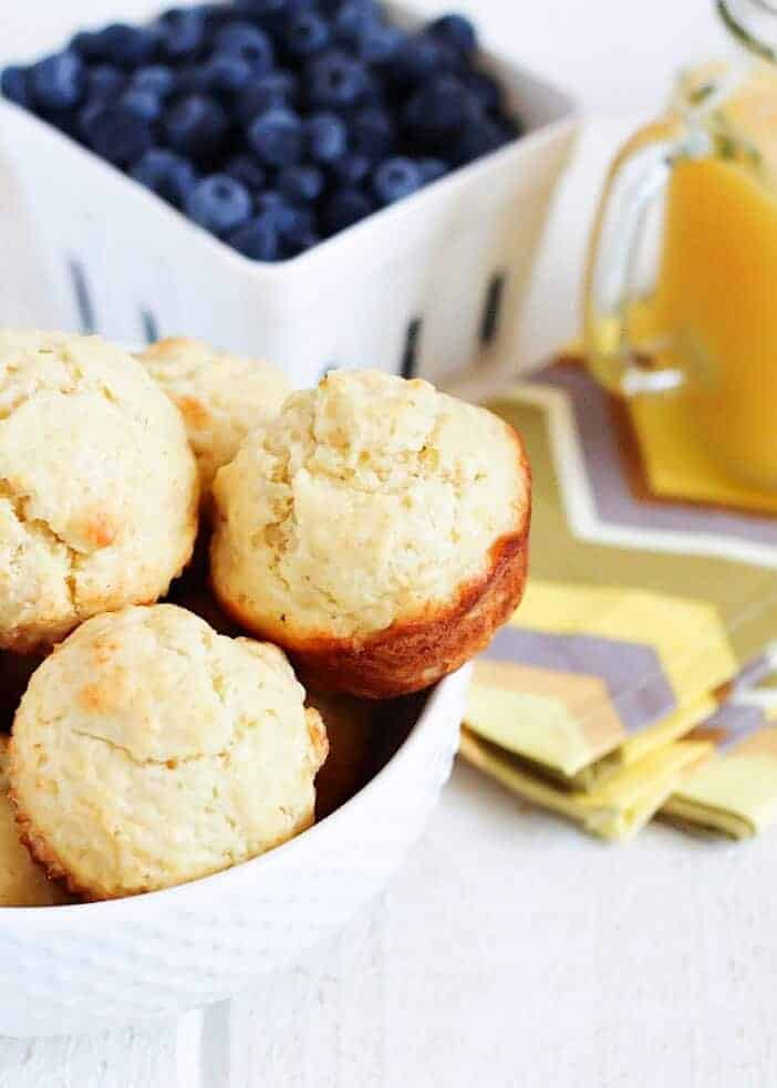 muffins and blueberries in white bowls