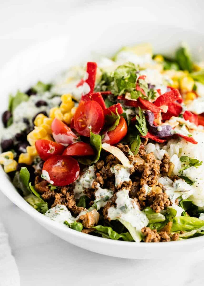 taco salad in bowl with toppings