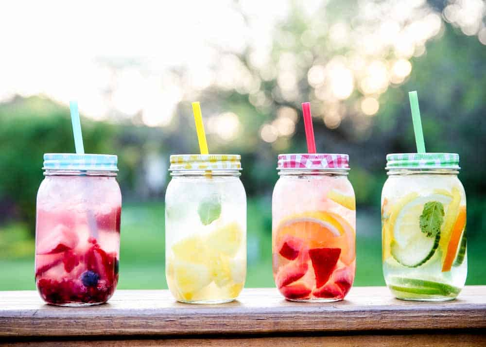 fruit water in mason jar cups