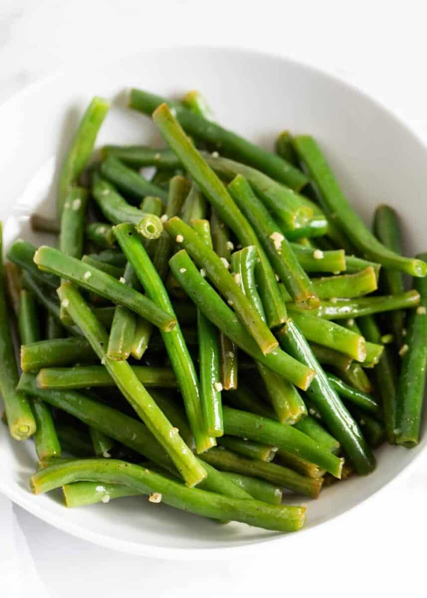close up of a bowl of cooked green beans