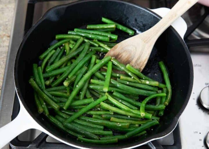 cooking green beans in pan on stove
