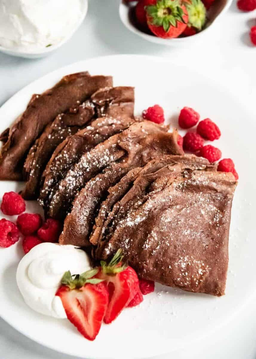 chocolate crepes on white plate