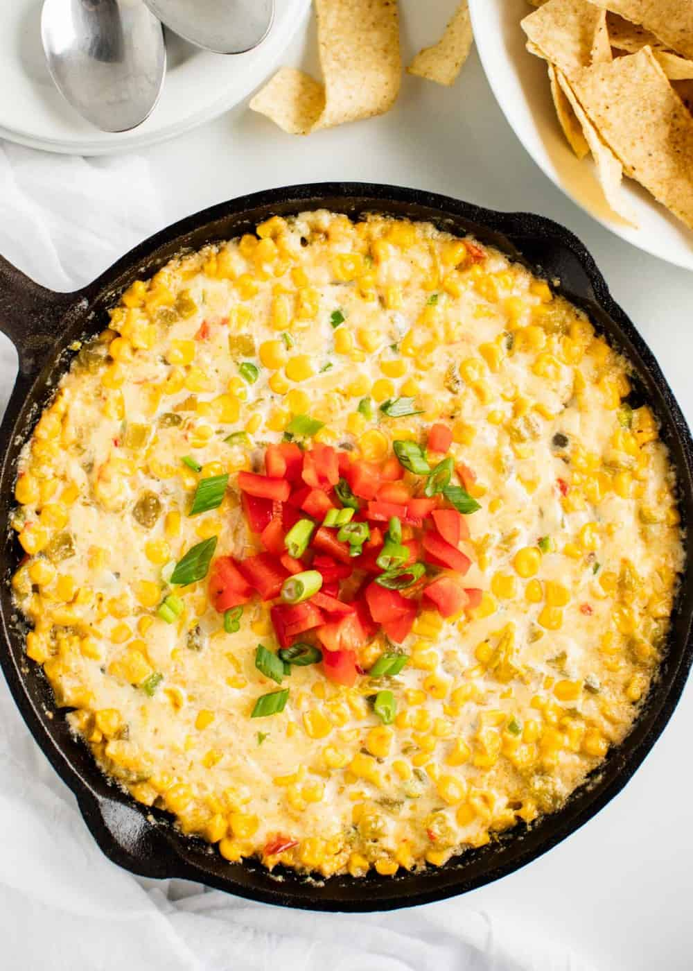 corn dip baked in skillet with tortilla chips