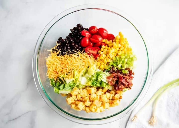cornbread salad ingredients in a glass bowl