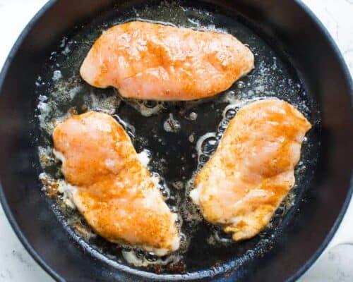 fajita chicken cooking in skillet