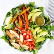 fajita chicken salad in white bowl