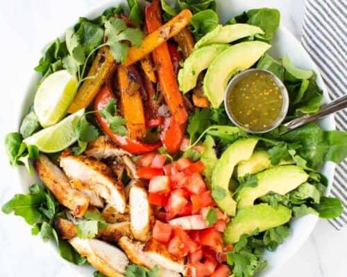 fajita chicken salad in white bowl