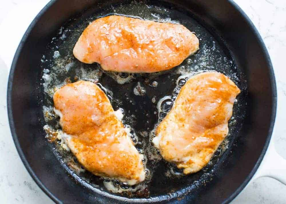 fajita chicken breasts cooking in skillet