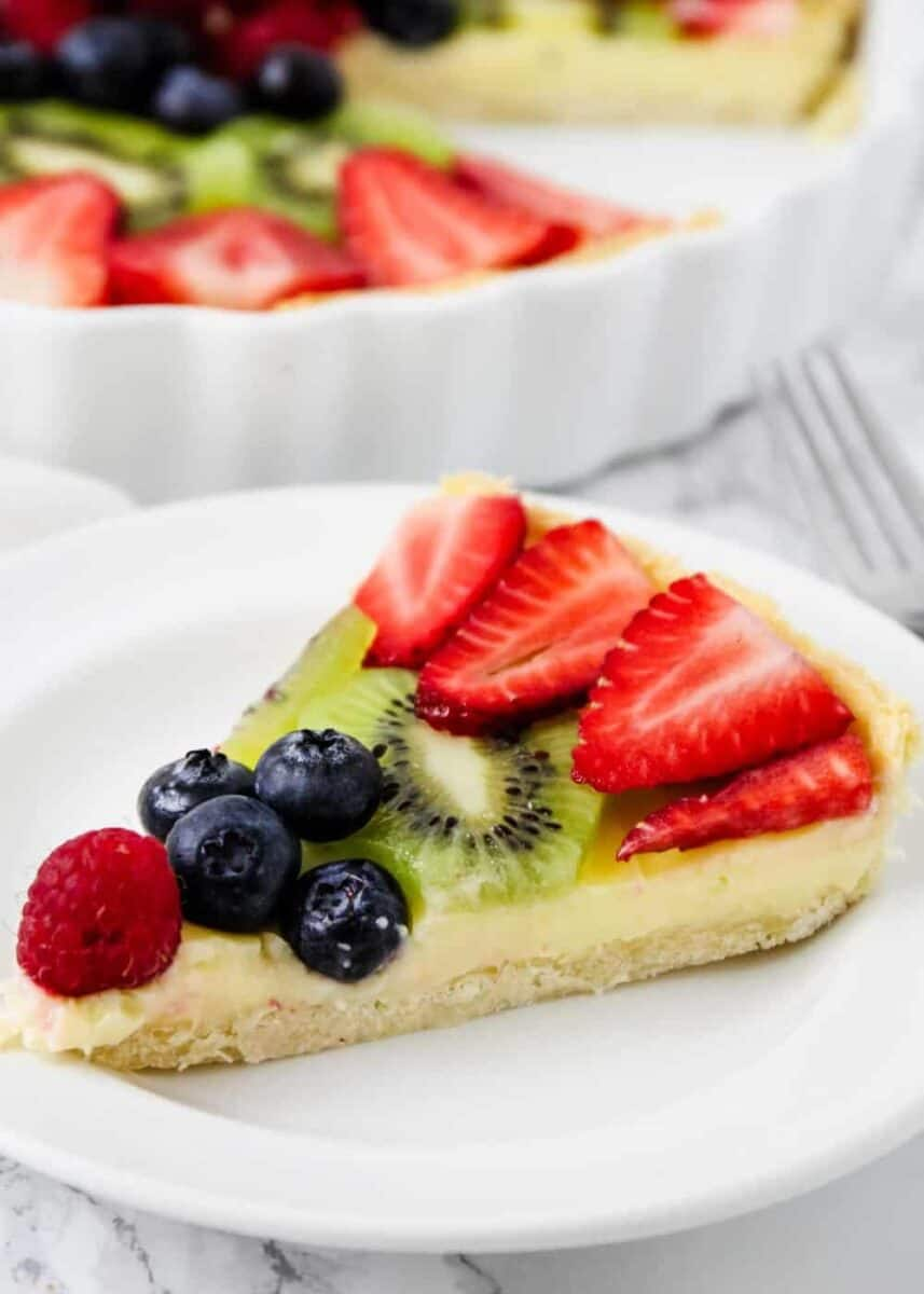 fruit tart slice on a white plate