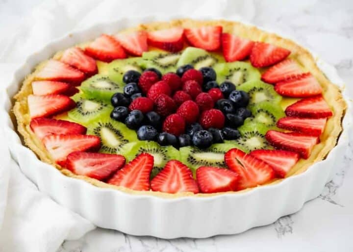 fruit tart in a white tart pan