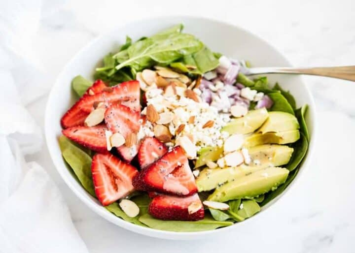 spinach and strawberry salad in bowl