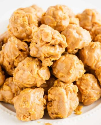 stack of cornflake cookies on a white plate