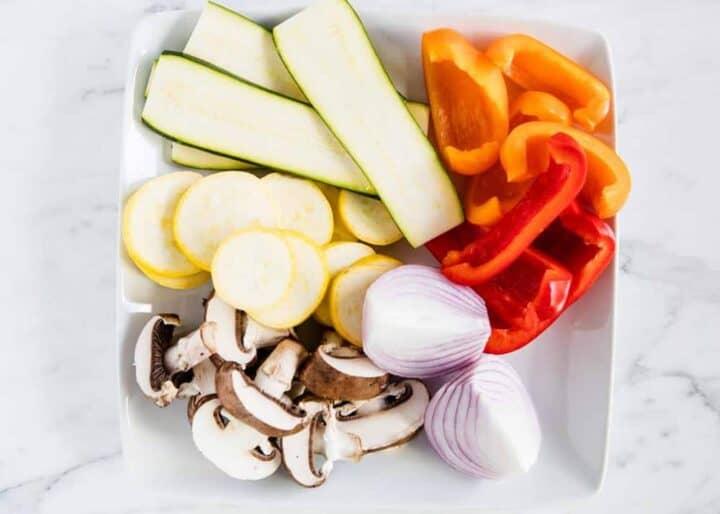 raw sliced vegetables on white plate