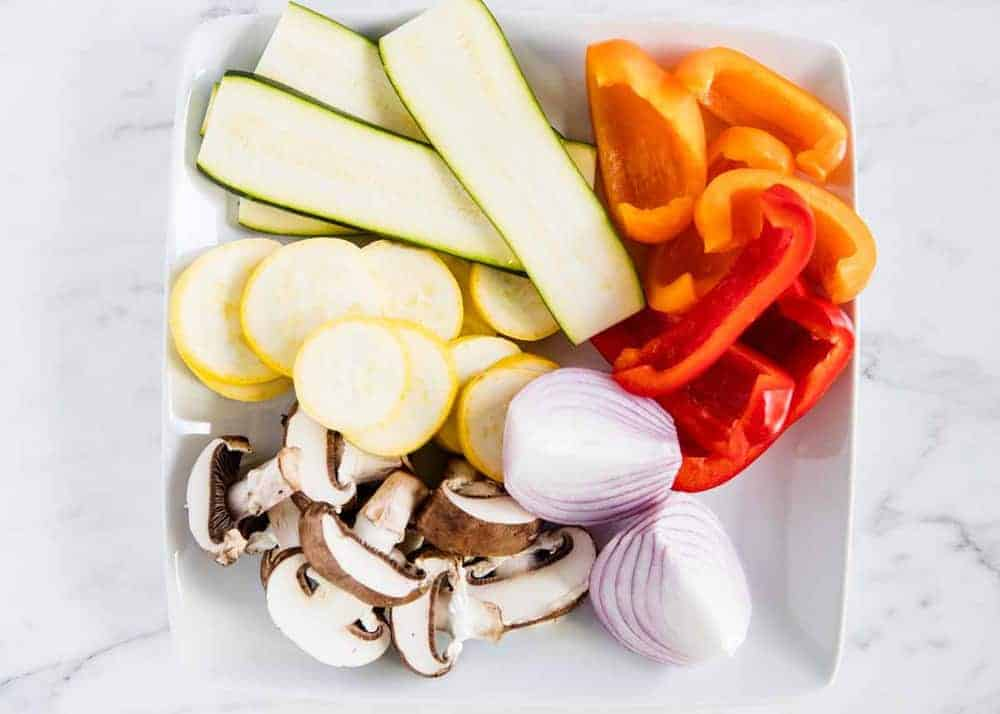 raw sliced vegetables on white plate