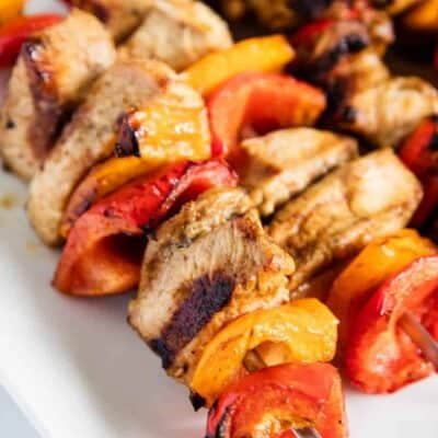cooked chicken kabobs on white plate