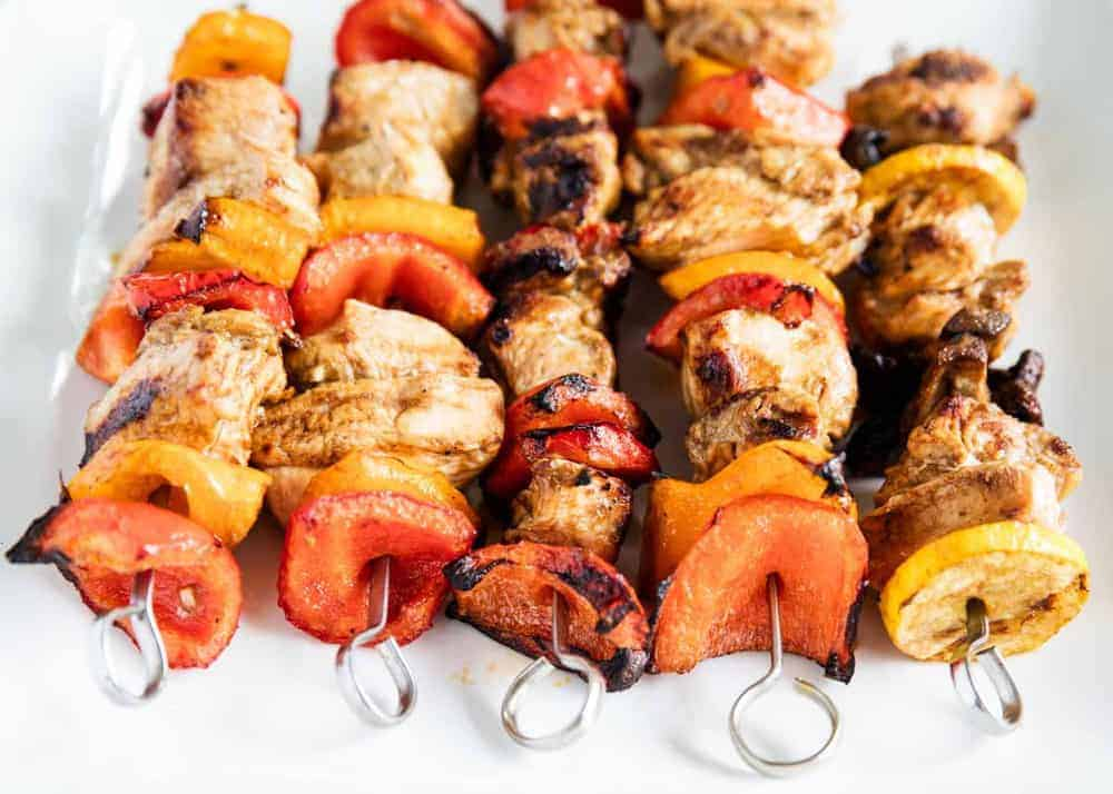 chicken kabobs on white plate