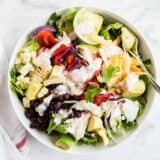 chicken taco salad with salsa ranch dressing in a white bowl