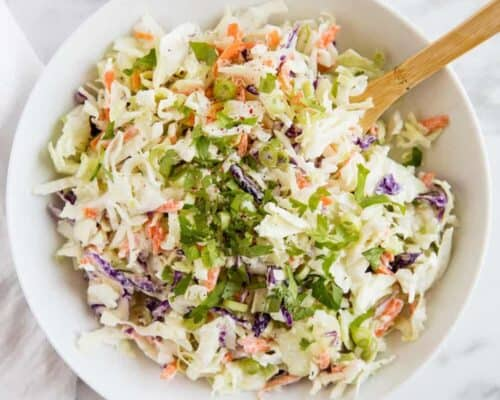 homemade coleslaw in a white bowl
