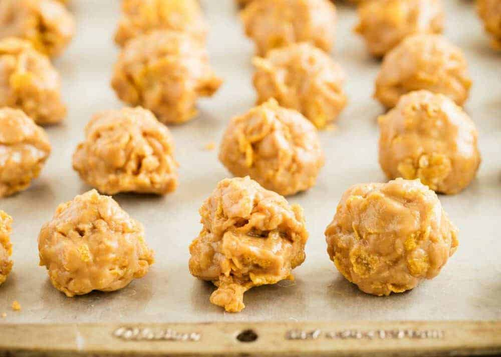 cornflake peanut butter balls on a baking sheet
