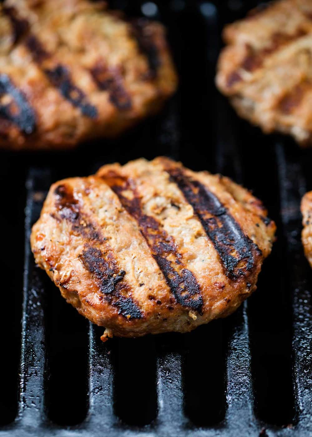 turkey burgers with grill marks on the grill
