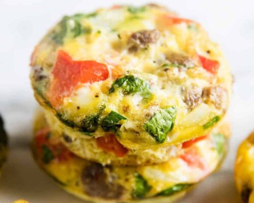 frittata muffins stacked on white plate