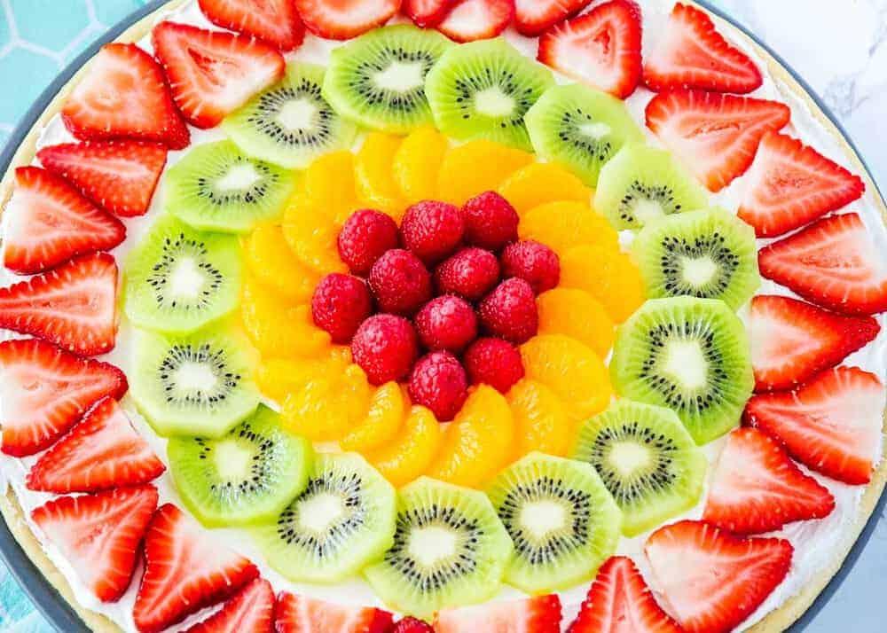 Fruit pizza with berries, kiwi, oranges and raspberries