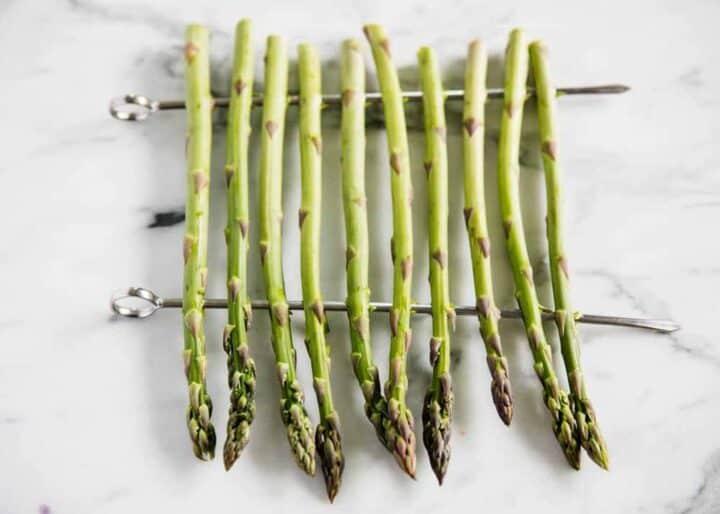 raw asparagus on skewers