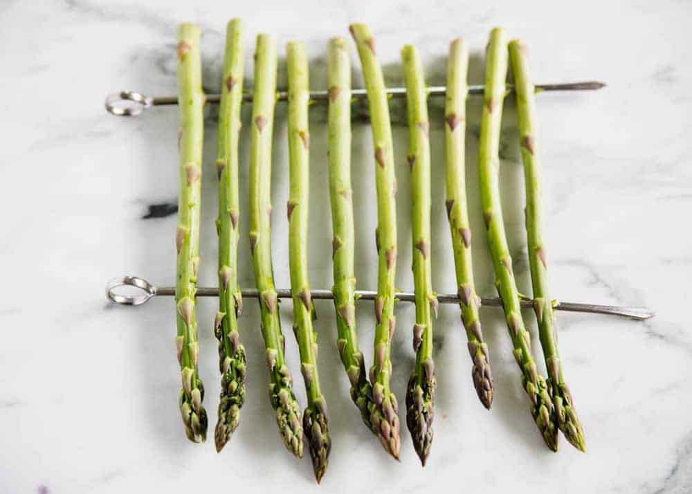 raw asparagus on skewers