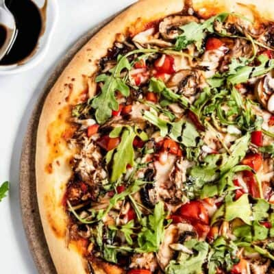 healthy pizza with vegetables and arugula