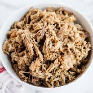 shredded kalua pork in a white bowl
