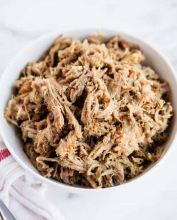shredded kalua pork in a white bowl