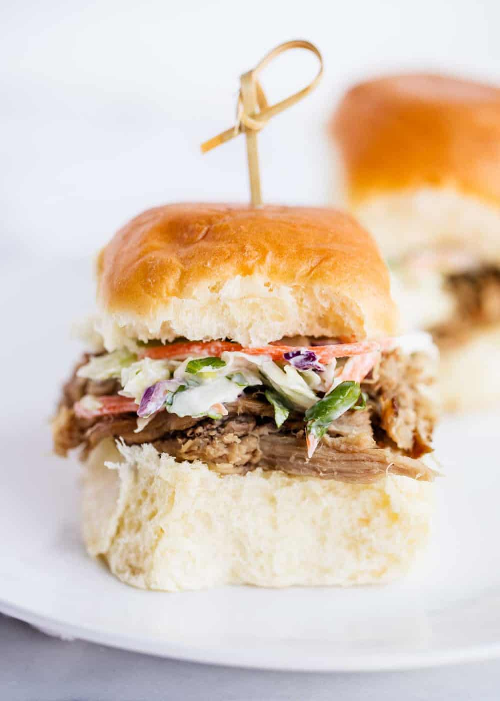 crockpot kalua pork sliders on a white plate