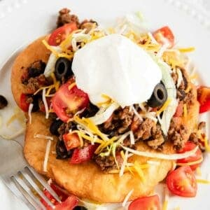 navajo taco with hamburger and sour cream