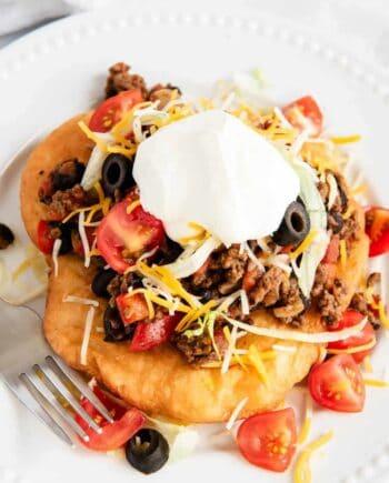 navajo taco with hamburger and sour cream