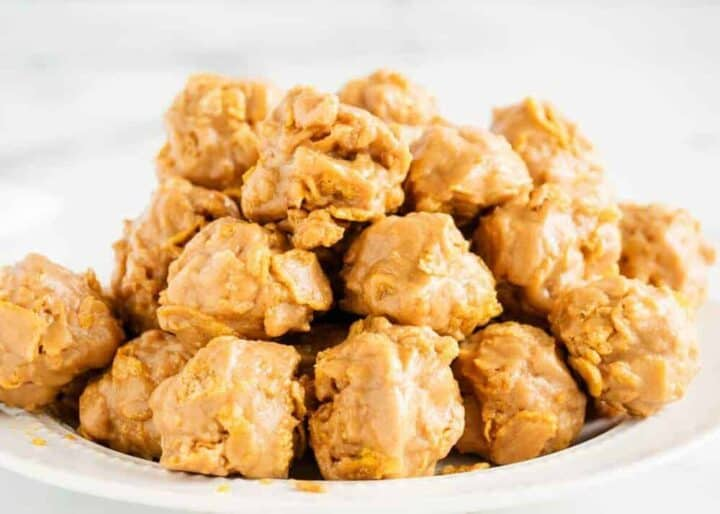 cornflake cookies stacked on a white plate