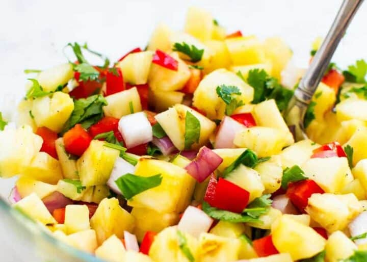 pineapple salsa in a bowl with a spoon