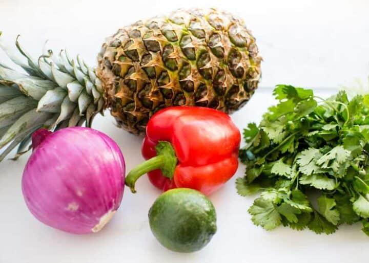 pineapple salsa ingredients on cutting board