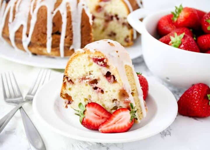 strawberry sour cream cake on white plate