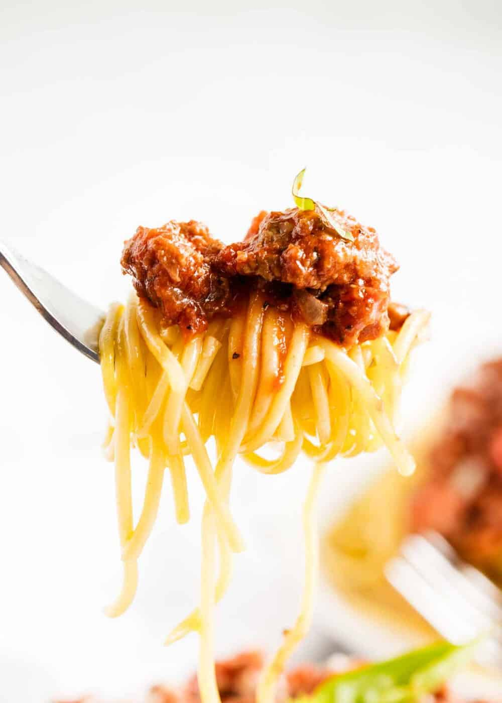 spaghetti with ground beef on a fork